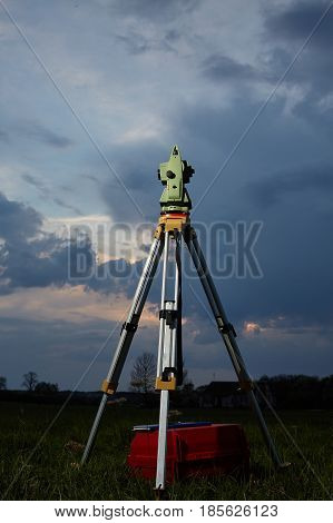 Surveying instrument total station on a tripod