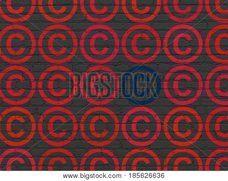 Law concept: rows of Painted red copyright icons around blue copyright icon on Black Brick wall background