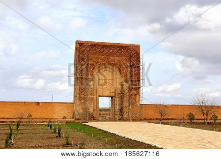Old-time central asian construction with ancient wall