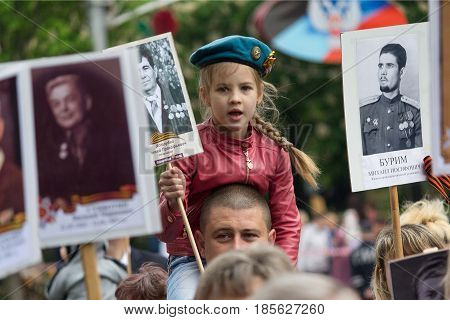 Donetsk Ukraine - May 9 2017: Participants of the action Immortal regiment with portraits of relatives of the deceased during the Second World War