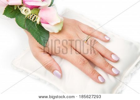 bridal hands with wedding ring and roses