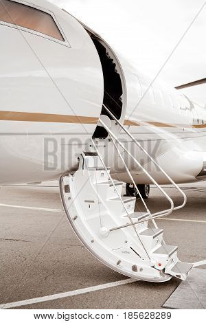 Private jet with ladder and open door