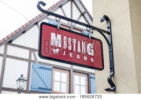 Roermond Netherlands 07.05.2017 - Logo of the Mustang jeans Store in the Mc Arthur Glen Designer Outlet shopping area