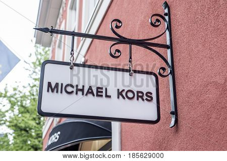 Roermond Netherlands 07.05.2017 Logo of the MK Michael Kors Store in the Mc Arthur Glen Designer Outlet shopping area