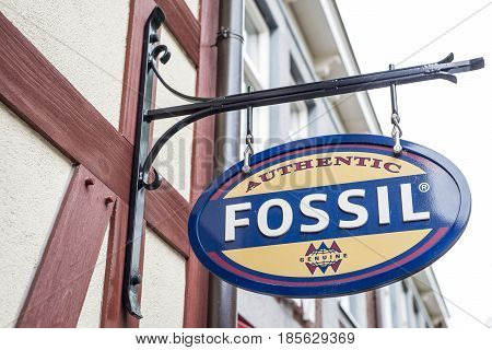 Roermond Netherlands 07.05.2017 - Logo of the Fossil clothes Store in the Mc Arthur Glen Designer Outlet shopping area