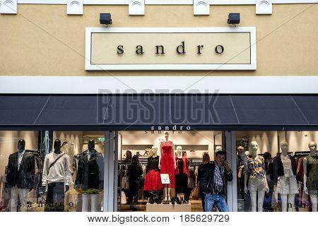 Roermond, Netherlands 07.05.2017 - Logo and shop of Sandro clothing Store Mc Arthur Glen Designer Outlet shopping area