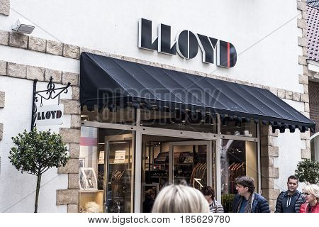 Roermond, Netherlands 07.05.2017 - Logo and shop of LLOYD Clothes Store Mc Arthur Glen Designer Outlet shopping area