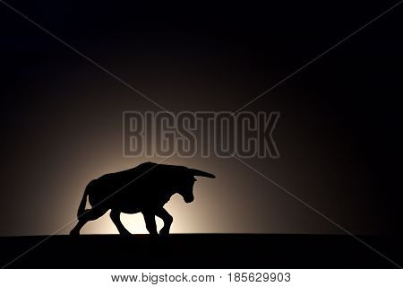 black bull silhouette on a dark background