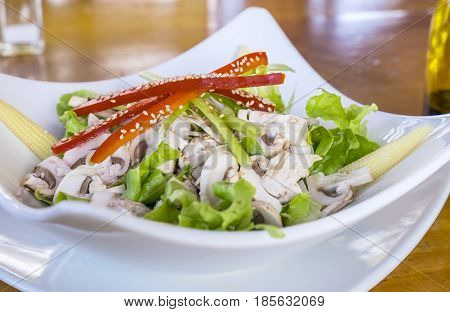 Bowl of Salad Made with Red Bell Pepper, Baby Corn,White Button Mushrooms and Boston Lettuce