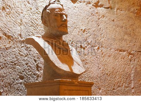 SPLIT, CROATIA - OCTOBER 19, 2016: Underground walls of Diocletian palace in Split, Croatia, emperor's marble bust