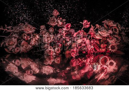 Wedding card Wedding rings. Wedding bouquet background. Flowering branch with white delicate flowers on wooden surface. Declaration of love spring. Dark background with smoke and heart. Love conept