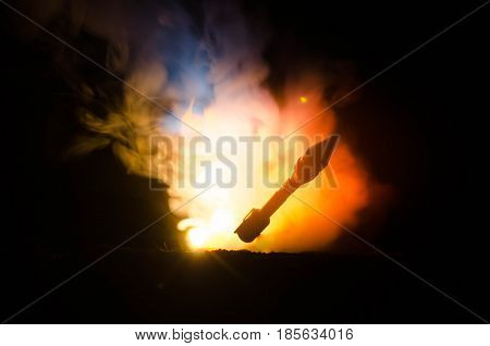 Rocket Launch With Fire Clouds. Nuclear Missiles With Warhead Aimed At Gloomy Sky At Night. Balistic