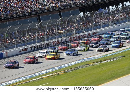 May 07, 2017 - Talladega, Alabama, USA: Denny Hamlin (11) leads the pack thru the tri-oval during the GEICO 500 at Talladega Superspeedway in Talladega, Alabama.