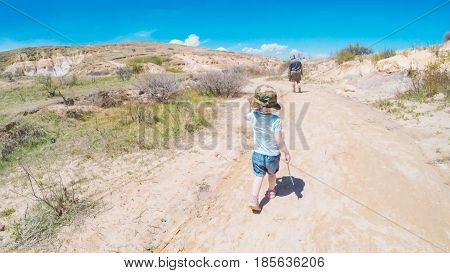 Little girl on a weekend hike with her dad in Paint Mines Interpretive Park in Colorado.