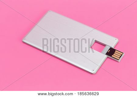 Credit card flash memory on a pink background
