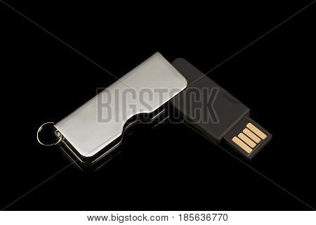 Flash drive on black background. Top view