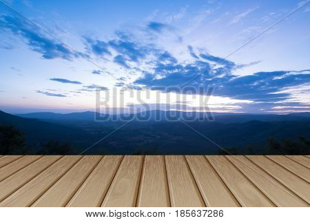 Wood table top on blur mountain background. Can be used for display or montage your products.