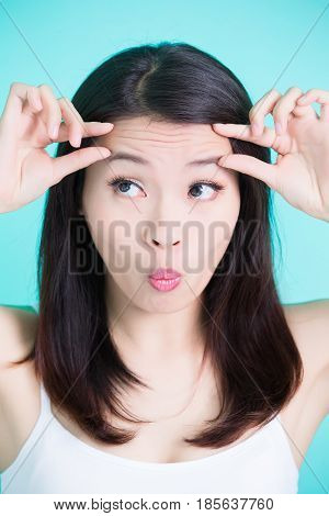 beauty skincare woman with wrinkle problem on green background