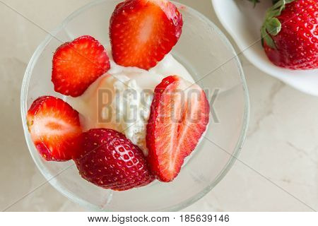 Ice cream with strawberries. Delicious and beautiful dessert.