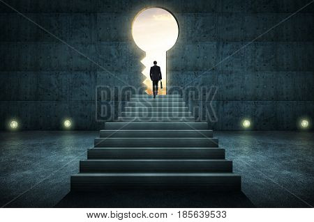 Sucess businessman climbing on stair against conrete wall with key hole door sunrise scene city skyline outdoor view .