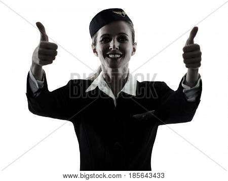 one caucasian Stewardess cabin crew  woman Thumbs Up isolated on white background in  silhouette