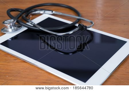 Tablet Computer with Stethoscope at Doctor's Office