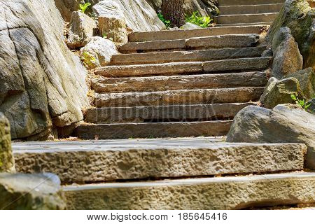 Beautiful old stone stairs. Natural stone steps in summer park