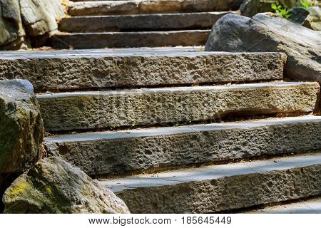 beautiful old stone stairs natural dark stone diabase with stone steps in summer park