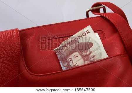 A battered five hundred Swedish kronor in a red leather bag.