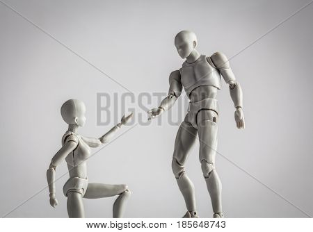 Relationship, Help, And Friendship Concept. Female Figurine Extending Hand Towards Male Figurine Clo