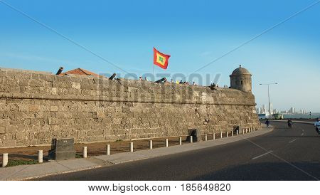 Cartagena de Indias, Bolivar / Colombia - April 10 2016: Tourists visiting the walled city. Cartagena's colonial walled city and fortress were designated a UNESCO World Heritage Site