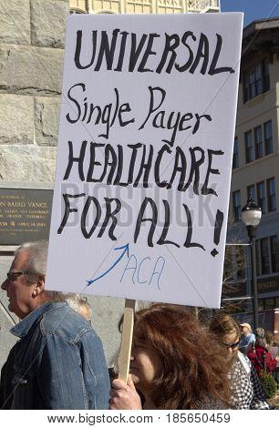 Asheville, North Carolina, USA - February 25, 2017: Woman holds a csign saying