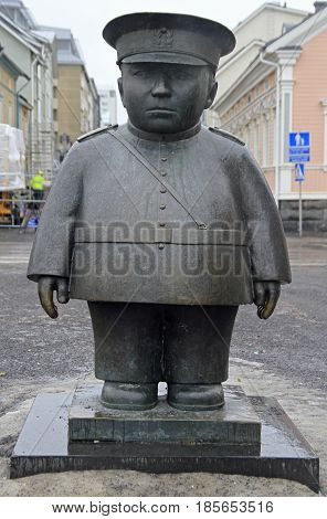 Oulu, Finland - April 11, 2017: Statue of policeman Bobby on market square in Oulu, Finland