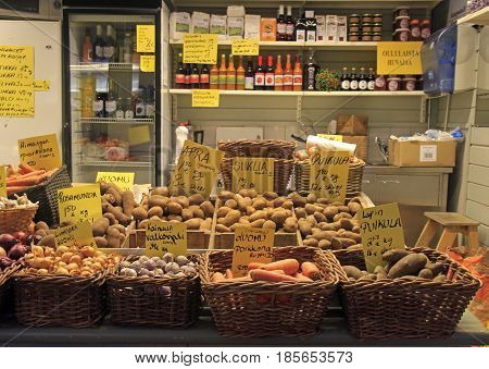 Oulu, Finland - April 11, 2017: stand with vegetables and beverages on street market in Oulu, Finland
