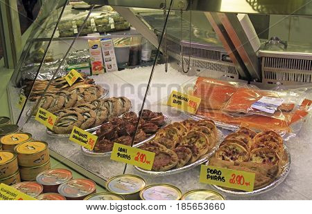 Oulu, Finland - April 11, 2017: stall with small pies and fish at market in Oulu, Finland