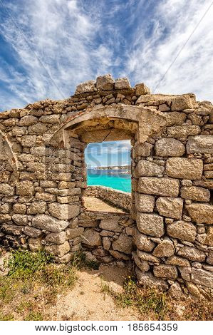 Turquoise Sea Viewed Through Window Of Derelict Building In Corsica