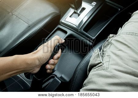 Driver pulling the hand brake in car for brake or drift for race.