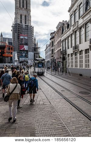 Ghent Belgium - July 31 2016: Cityscape of Ghent with tram and a crowd of tourists