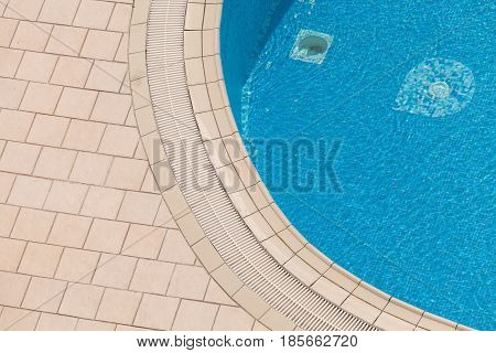 Edge of beautiful luxury swimming pool. Top view