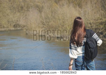 Beautiful Woman Stands Near River, Back Side