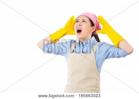 Young housewife having a calamity at home reacting in shock and horror as she see the mess house. isolated on white background. housework and household concept. poster