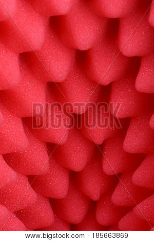 Red foam acoustic, safe packaging material as background