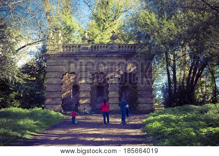 Bristol UK - April 02 2017:Familly walking to see the Vanbrugh's Echo pavilion showing the lost statue at the centre. The Echo is a loggia at the end of the southeast axis of the Kings Weston house in Bristol Uk