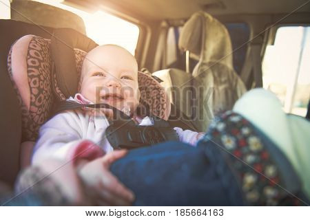 Cute toddler boy sitting in car seat safety child transportation