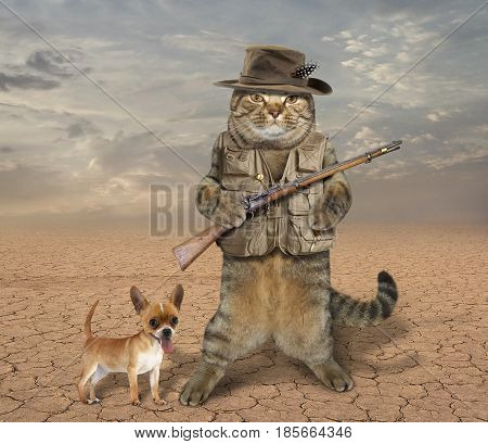 The cat hunter is holding a real rifle. His dog is next to him.