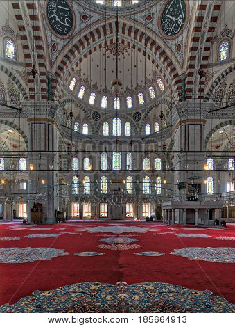 Istanbul, Turkey - April 20, 2017: Fatih Mosque a public Ottoman mosque in the Fatih district of Istanbul Turkey with a huge arches decorated domes and colored stained glass windows