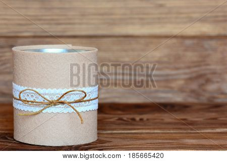 Decorative tin can for pencils, pens, markers and scissors. Recycled tin can for storage of stationery isolated on wooden background with empty copy space for text. Closeup