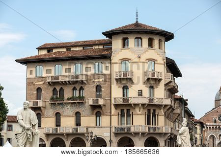 PADUA ITALY - MAY 3 2016: The old residential houses decorated with mosaic tiles and pattern maid from bricks Prato della Valle in Padua. Italy