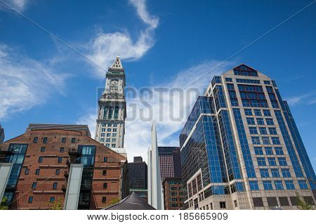 BostonMassachussettsUSA - July 22016: Architecture in Boston harbor. It is a natural harbor and estuary of Massachusetts Bay. Boston tourism annually brings about 8 billion dollars
