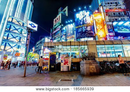 TAIPEI TAIWAN - APRIL 18: This is Ximen shopping district and Ximen MRT station it is a very popular shopping area in Taipei at night on April 18 2017 in Taipei